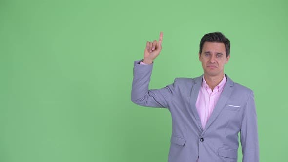 Thumbnail for Stressed Young Businessman Pointing Up