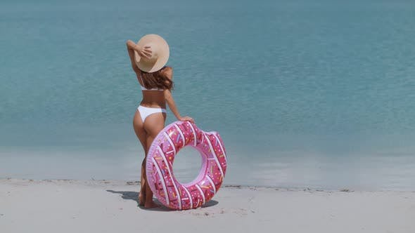 Thumbnail for Woman on the Beach with a Rubber Ring.