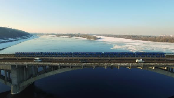 Thumbnail for Aerial View Subway Train Riding on Bridge Railway Over River Highway at Winter