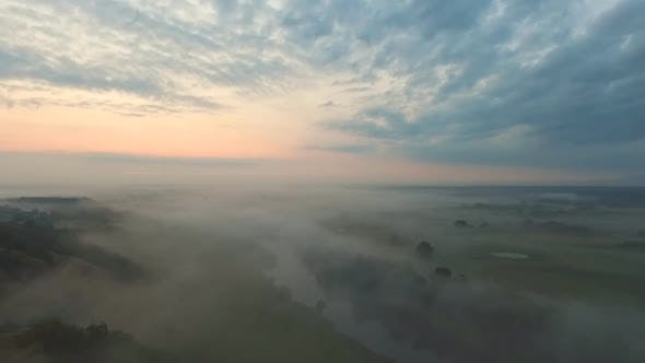 Aerial Shot of Beautiful Countryside Environment in Early Morning. Amazing Scenic View on Misty