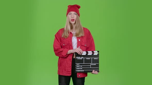 Assistant Holds a Clapperboard in the Hands. Green Screen