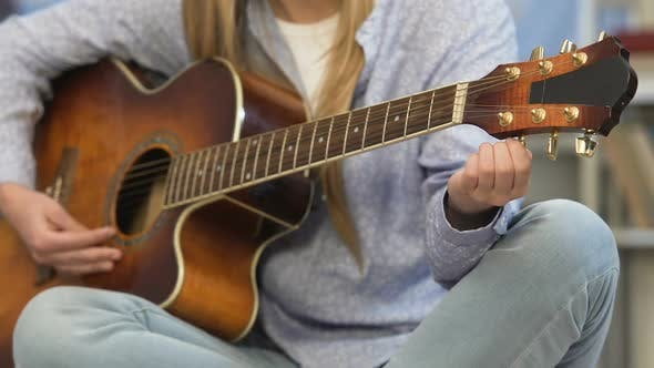 Thumbnail for Girl Tuning Guitar Preparation Before Concert Young Composer Music Lesson