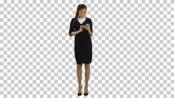 Young businesswoman using mobile phone, Alpha Channel