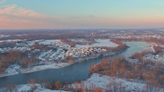 Aerial View of Amazing Winter Sunset in Suburb City with Snow Covered Residential Quarters By the