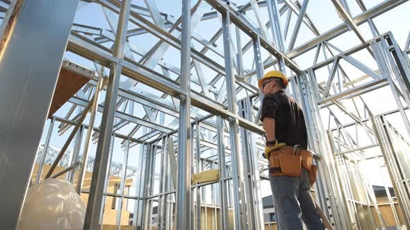 Skeleton Steel Frame Structure and the Caucasian Construction Worker