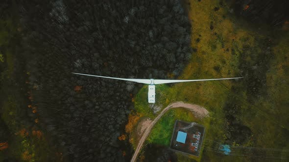 Thumbnail for Static Top View Drone Shot, Windmill Turbine Spinning in the Middle of Green Forest, Alternative