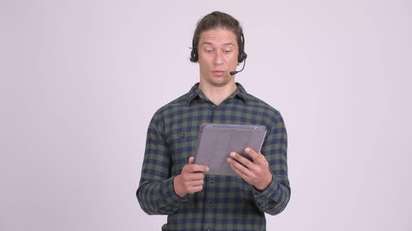 Cover Image for Stressed Man As Call Center Representative Using Digital Tablet