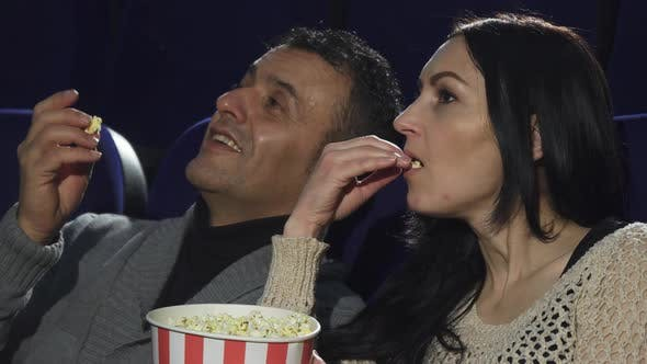 Thumbnail for Close Up of a Mature Couple Watching a Movie Together at the Cinema