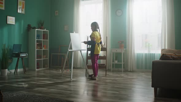 Small Girl Enters Shot and Starts Painting