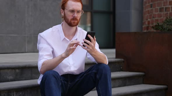 Thumbnail for Portrait of Designer Busy Using Smartphone