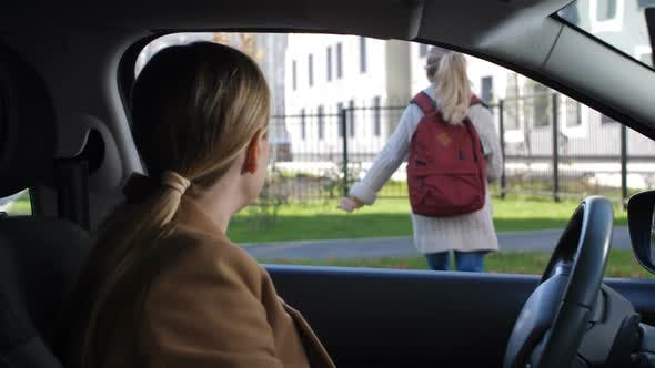 Thumbnail for Mother Giving Kiss Goodbye To Girl Before School