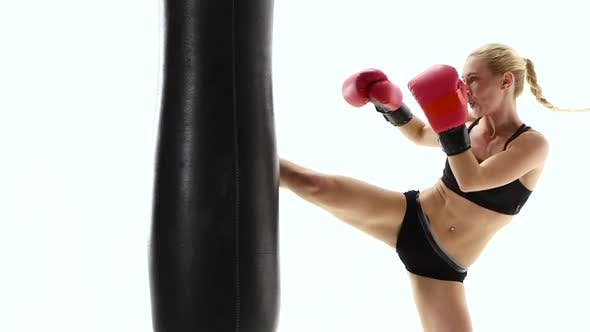 Thumbnail for Strong Girl Boxing Champion Fulfills Blows on the Punching Bag