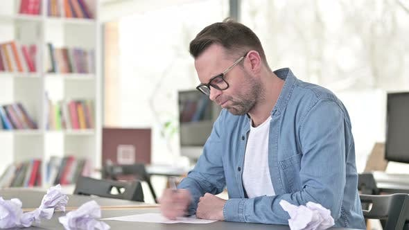 Upset Young Man Trying To Write, Tearing