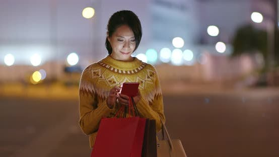 Thumbnail for Woman Hold with Shopping Bag and Use of Mobile Phone in City