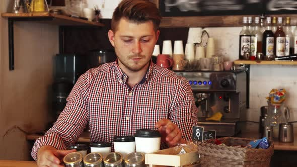 Thumbnail for Barista Clears the Bar Counter