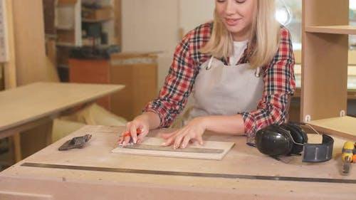 Hardworking Woman Woodworker Make Drawings