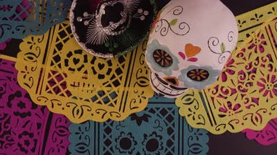 Decorations for traditional Mexican holiday Day of the Dead on a black background