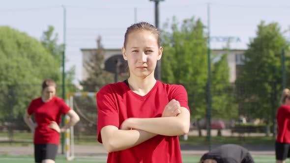 Thumbnail for Confident Soccer Girl Posing with Arms Crossed on Outdoor Field