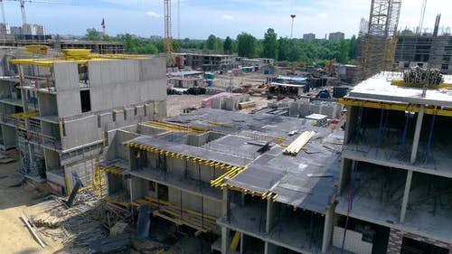 Construction of a monolithic building. Park and residential area in background