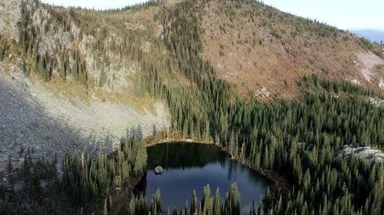 Flight Over Watch Lake in Rocky Forested Gypsy Ridge Area