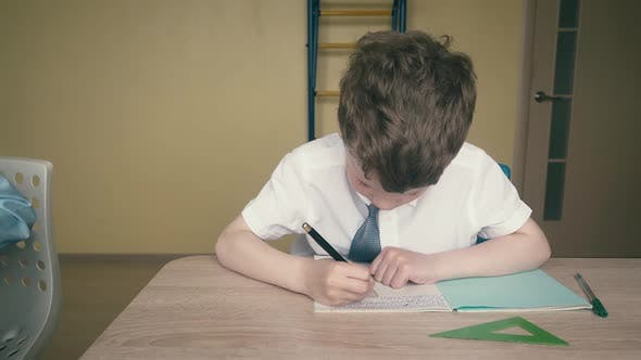 Travelling: Pupils, Little Boys, Do Their Homework. One of Them Makes a Drawing in a Notebook
