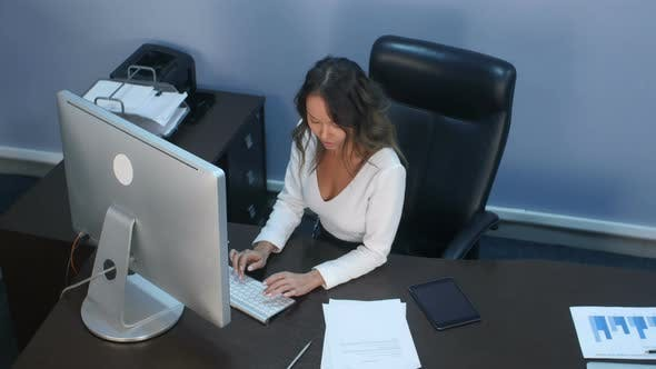 Thumbnail for Beautiful Business Lady Working with Digital Tablet and Documents in Office