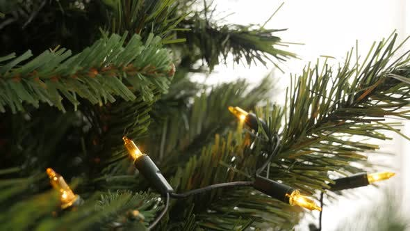 Thumbnail for Close-up of Christmas bulbs on artificial tree branches 4K 2160p 30fps UltraHD tilting footage - Slo