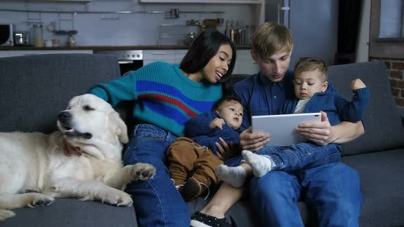 Thumbnail for Family with Pet Dog Browsing Online on Tablet Pc