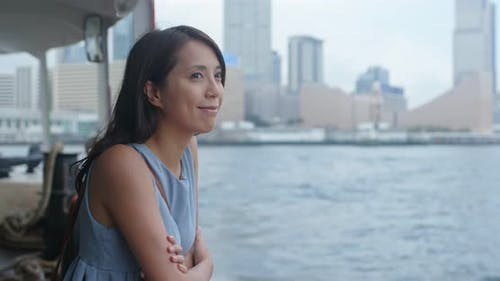 Woman visit Hong Kong city and take the ferry