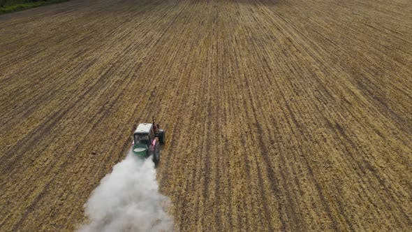 The Tractor Spreads Mineral Fertilizers To Improve The Harvest