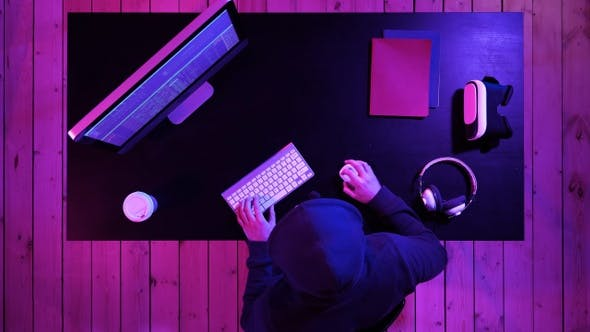 Cover Image for Dangerous Hooded Hacker Breaks into Government Data Servers