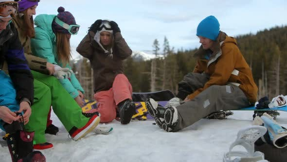 Thumbnail for Group of young people prepare to go snowboarding