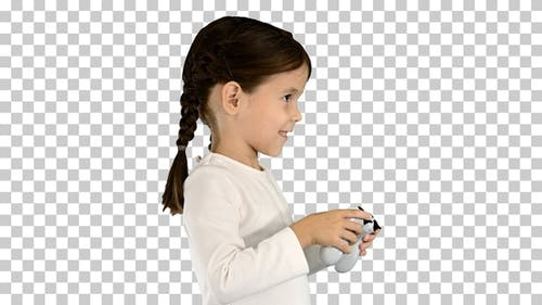 Excited little girl play videogame holding, Alpha Channel