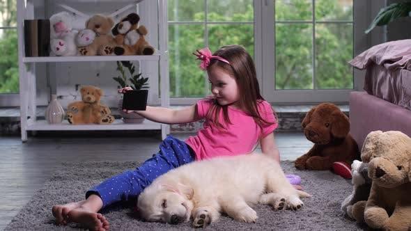 Thumbnail for Adorable Little Girl Posing for Selfie on Floor