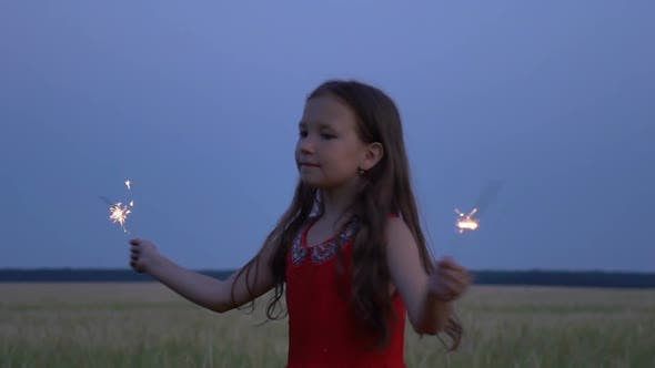 Thumbnail for Portrait of a Girl with Sparklers in Their Hands at Evening.