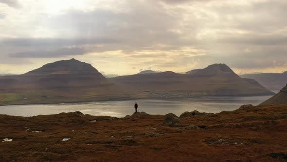 Thumbnail for Man Standing In Awe Of Mountains And Landscape
