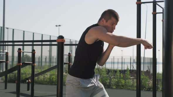 Boxer Practicing Punches Outdoors