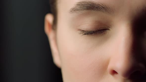 Extreme Close Up of Half Face Shot of Serious Female Face Indoors