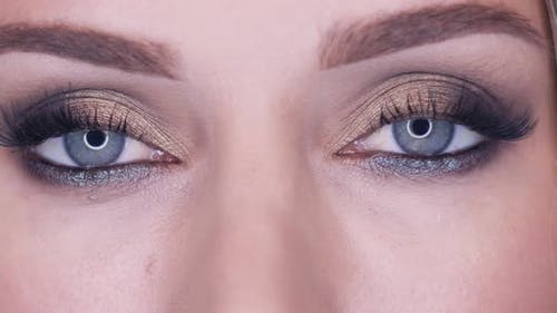 Sensual Girl Opens Her Eyes with Smokey Eyes Effect Makeup