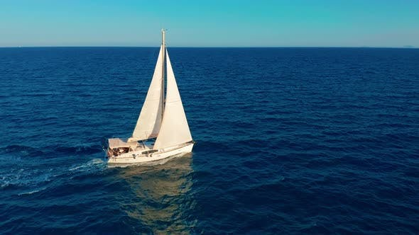 Thumbnail for Sailboat in the Ocean. White Sailing Yacht in the Middle of the Boundless Ocean.