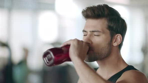 Thumbnail for Concentrated Man Drinking Water in Fitness Gym