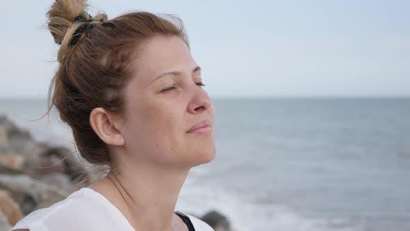 Thumbnail for Blonde  caucasian woman near sea water slow motion 1080p FullHD video - Female relaxing on ocean bea