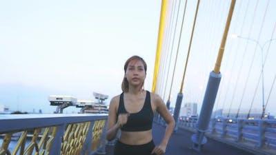 Young Athlete Running on Bridge