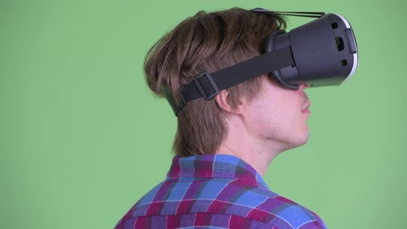 Thumbnail for Closeup Rear View of Young Hipster Man Using Virtual Reality Headset