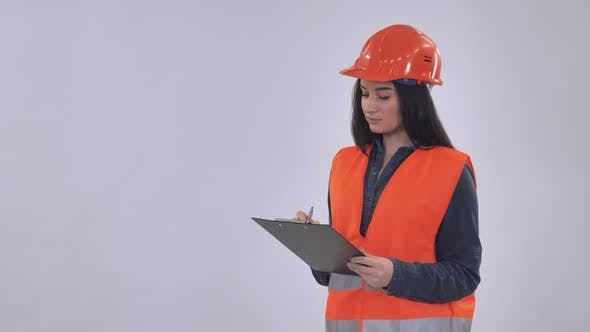 Caucasian Manager Wearing Hard Hat Fill Form