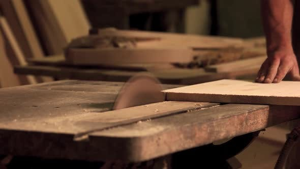 Professional Carpenter Working at His Workshop