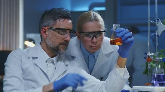 Thumbnail for Scientists Examining Various Liquids