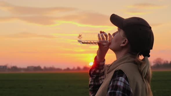 Thumbnail for Tired Farmer Woman Drinking Clean Water From Bottle at Sunset
