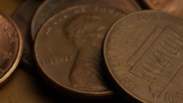 Rotating stock footage shot of American pennies (coin - $0.01) - MONEY 0183