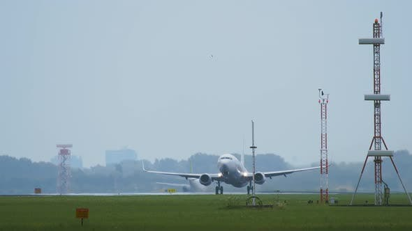 Thumbnail for Twin Engine Widebody Airplane Takes off in the Morning